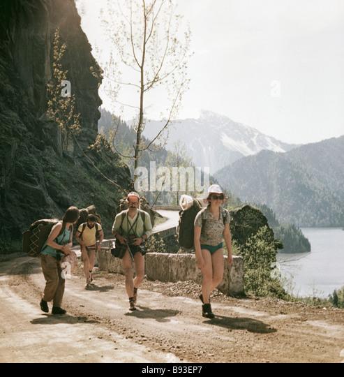 Tourists travel in the Abkhazia mountains - Stock Image
