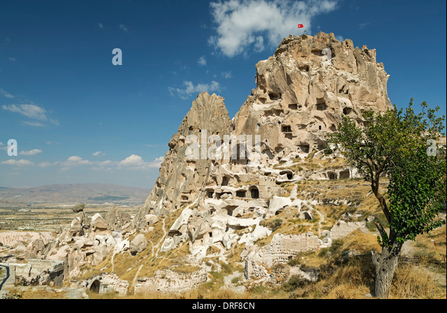 Fairy chimneys and The Castle, Uchisar, Cappadocia, Turkey - Stock Image