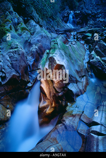 water sculpted rocks at dusk Falls of Bruar Perthshire Scotland UK - Stock Image