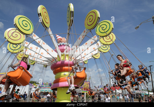 Florida Plant City Florida Strawberry Festival annual event carnival ride midway spinning kiddie swing - Stock Image