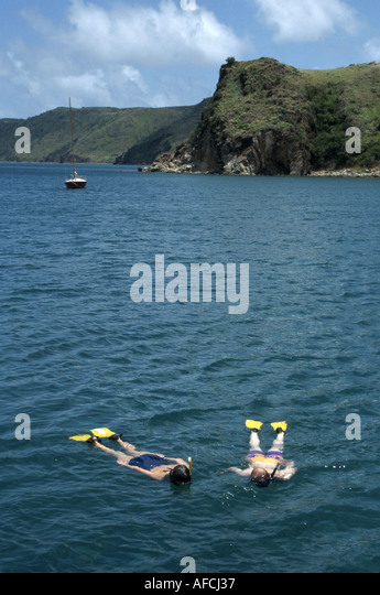 West Indies St. Kitts White House Bay two snorkelers near North Point - Stock Image