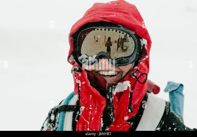 Woman wearing ski goggles - Stock-Bilder