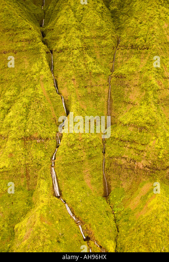 Hawaii Kauai Aerial view of waterfalls and the lush velvet green mountains of the Napali Coast northshore - Stock Image