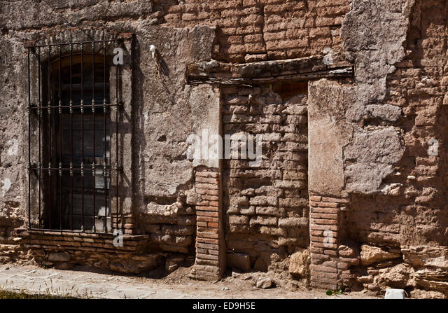 An old adobe wall and window in historic MINERAL DE POZOS which was once a large mining town - MEXICO - Stock Image