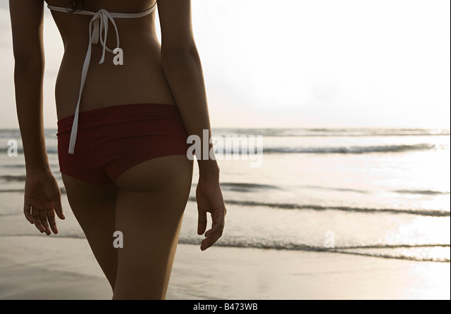 Young woman by the sea - Stock Image