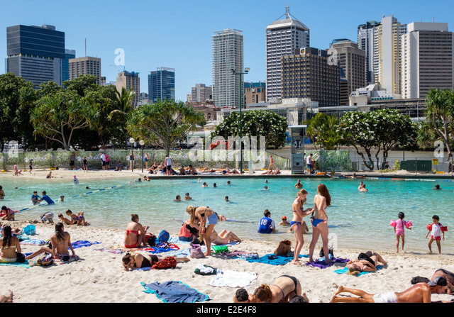 Brisbane Australia Queensland Southbank Parklands Streets Beach sunbathers sand water Central Business District - Stock Image