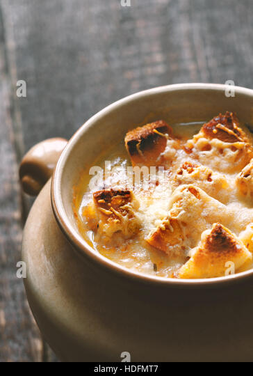 Onion soup in the ceramic pot vertical - Stock Image