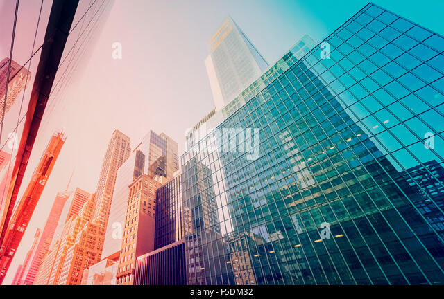 Vintage toned Manhattan skyscrapers at sunset, NYC, USA. - Stock Image