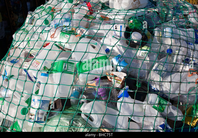 Plastic waste for recycling at recycling collection station in car park UK - Stock Image