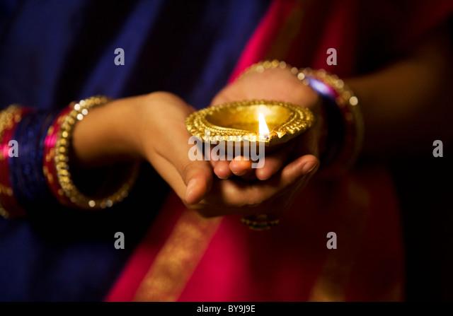 Woman holding a diya - Stock-Bilder