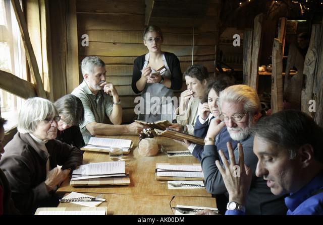 UK, England, Alnwick, The Alnwick Garden, Treehouse Restaurant, table, waitress, orders, - Stock Image