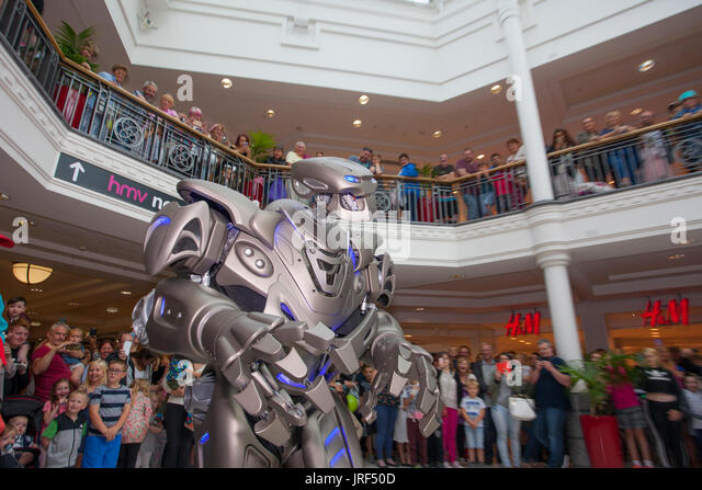 Preston, Lancashire, UK . Titan the robot wows the crowds at St George's Centre. Titan is the stage name of - Stock Image