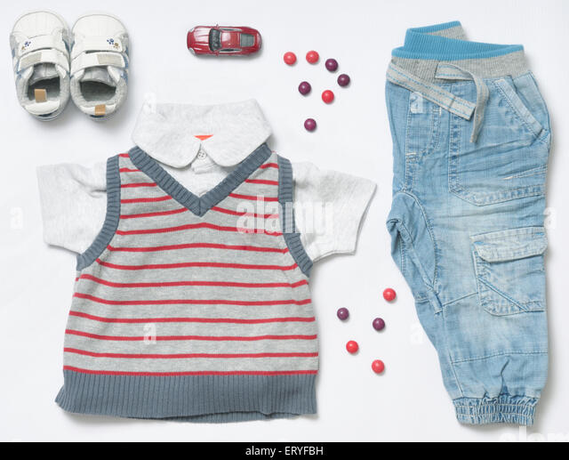 top view fashion trendy look of baby clothes and toy stuff, baby fashion concept - Stock Image