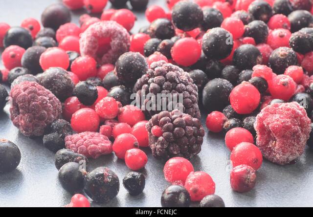 closeup to frozen mixed fruits - Stock Image