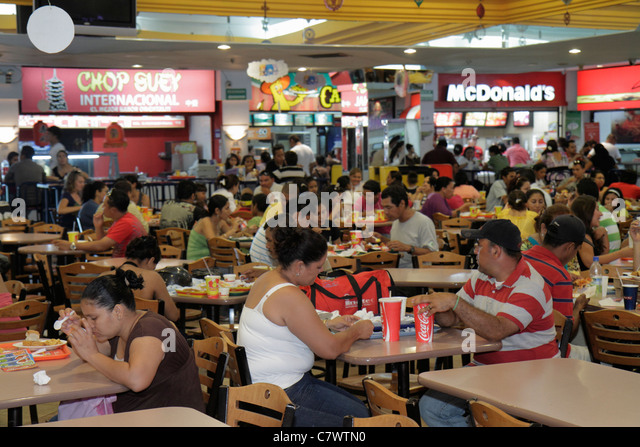 Managua Nicaragua Avenida Simon Bolivar Plaza Inter shopping mall crowded food court fast food restaurant business - Stock Image