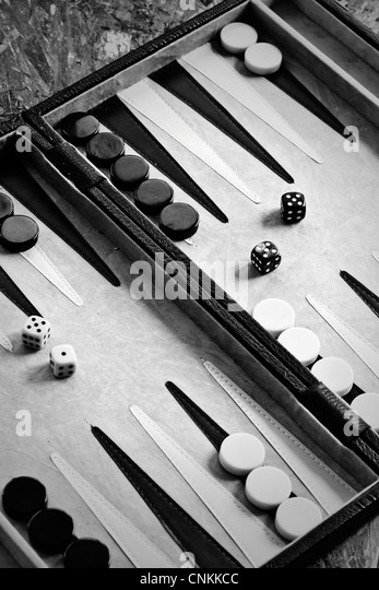Backgammon game with playing pieces and dice - Stock Image