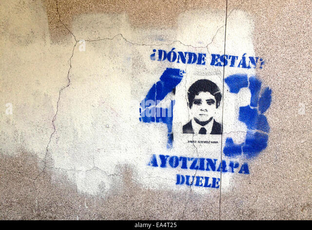 Mexico city, Mexico. 6th November, 2014. A portrait of missing student Antonio Santana is displayed in Reforma Avenue - Stock Image