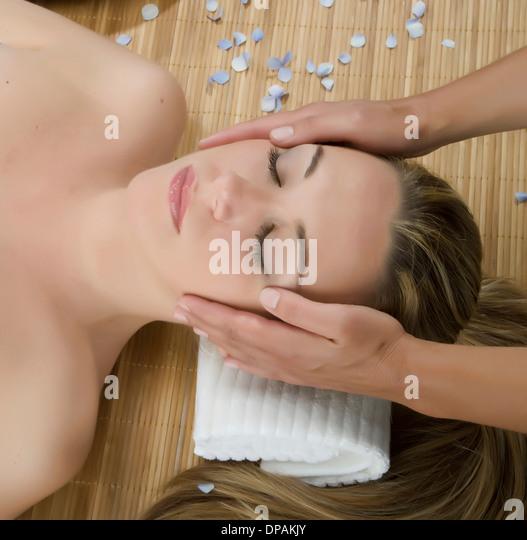 Close up of woman having head massage - Stock-Bilder