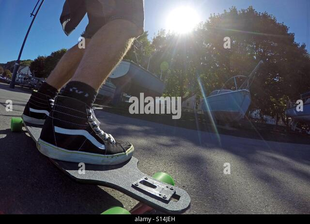 Skateboarding on the seafront at Mumbles near Swansea. - Stock Image