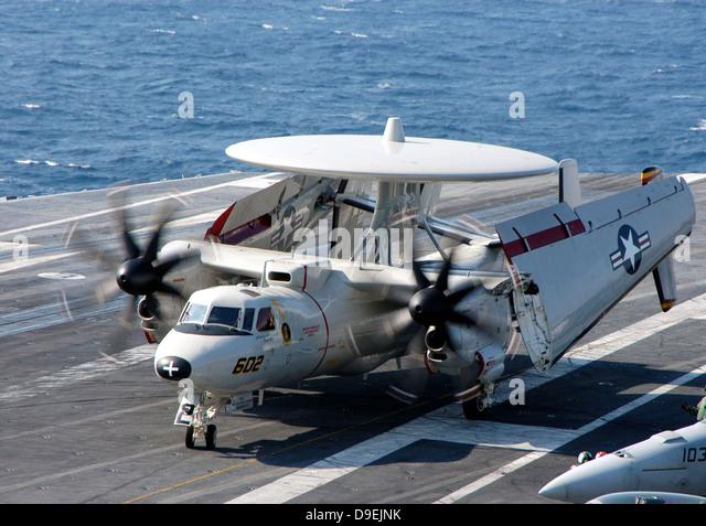 An E-2C Hawkeye taxiing on the flight deck aboard USS Dwight D. Eisenhower - Stock Image