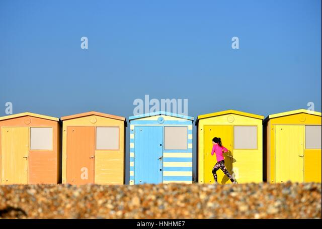 Seaford, East Sussex, UK. 13th Feb, 2017. UK Weather. Jogger enjoying a seaside run in the evening sun after a beautifully - Stock-Bilder