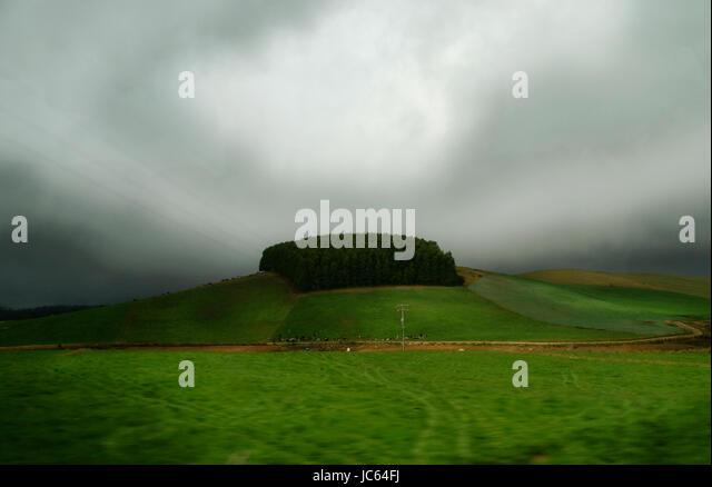 farm land under a cloudy sky. Tasmania, Australia - Stock Image