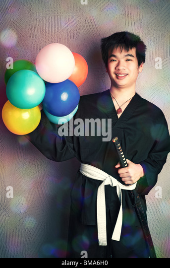 Happy samurai with balloons. Humour and queer concept. - Stock Image
