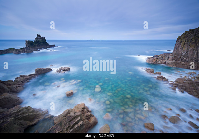 Looking towards Longships lighthouse from Land's End, Cornwall, England. Winter (February) 2013. - Stock Image