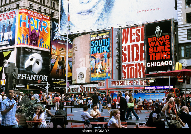 Giant adverts for Broadway shows and musicals, Duffy Square (next to Times Square), New York City - Stock Image