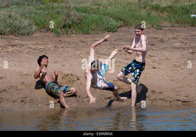 Blakeney Quay, Norfolk, UK, 01st July, 2015. Blakeney Quay, Norfolk, UK, 01st July, 2015. Teenagers, Olly Short, - Stock Image