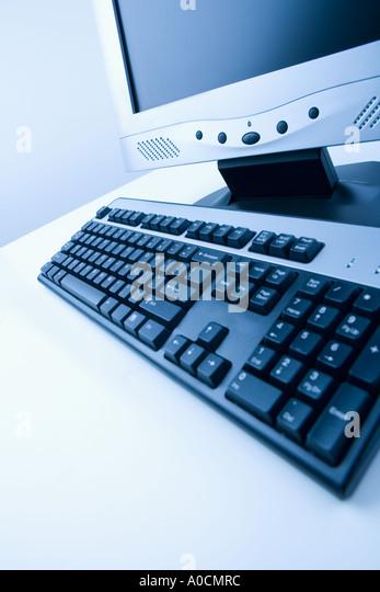 Still life of monitor and keyboard - Stock Image