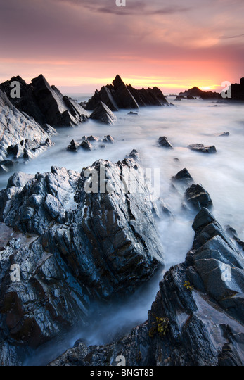 Rocky shores at Hartland Quay at sunset, North Devon, England. Spring (May) 2010. - Stock Image