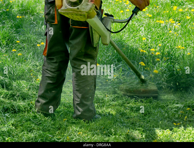 how to cut long grass with a mower