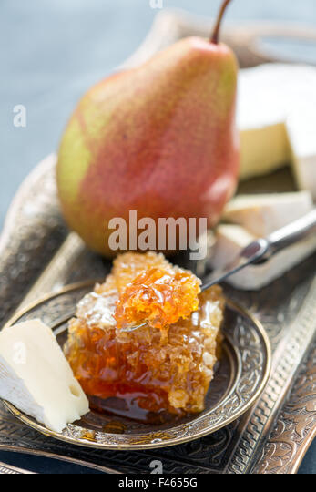 Brie cheese, honey and pear. - Stock Image