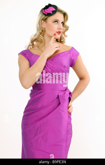 Pretty blonde in fuchsia dress - Stock Image