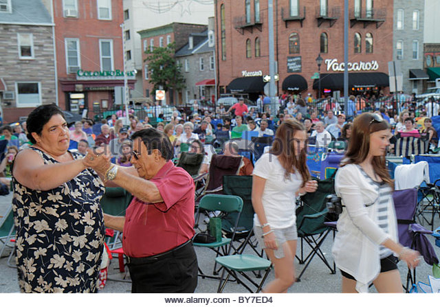 Maryland Baltimore Little Italy ethnic neighborhood working class community event crowd free outdoor movie lounge - Stock Image