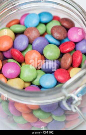 Smarties in a jar - Stock Image