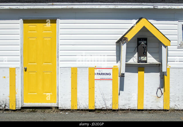 Building with pay phone in Twillingate Harbour - Twillingate, Newfoundland, Canada - Stock Image