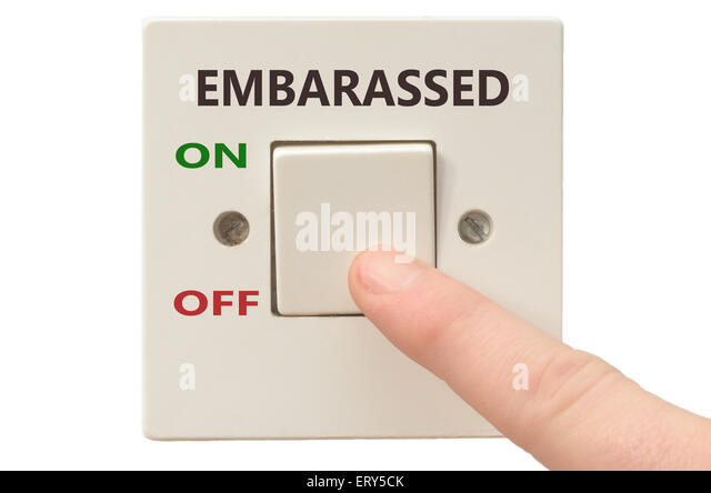 Turning off Embarassed with finger on electrical switch - Stock Image
