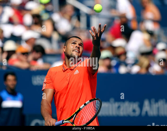 New York, USA. 6th September, 2015. Jo-Wilfried Tsonga of France in action against countryman Benoit Paire in their - Stock Image