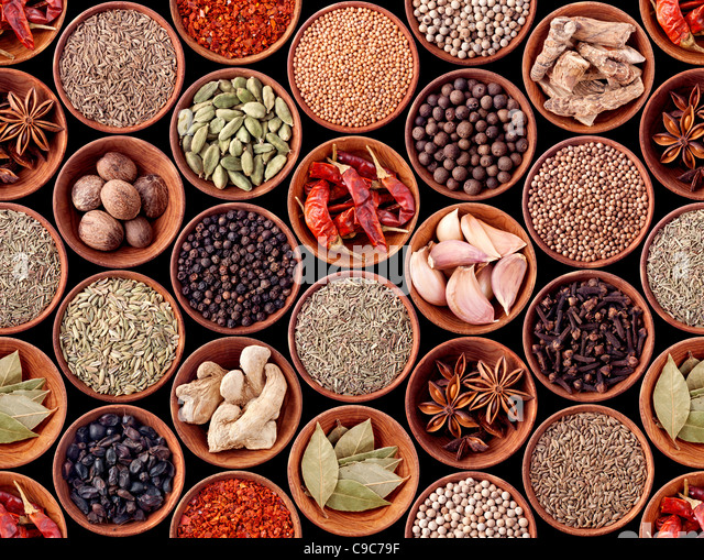Seamless texture of spices on black background - Stock Image