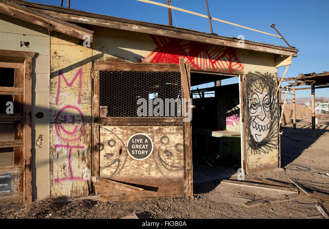 Graffiti on an abandoned building in Bombay Beach on the Salton Sea California - Stock Image