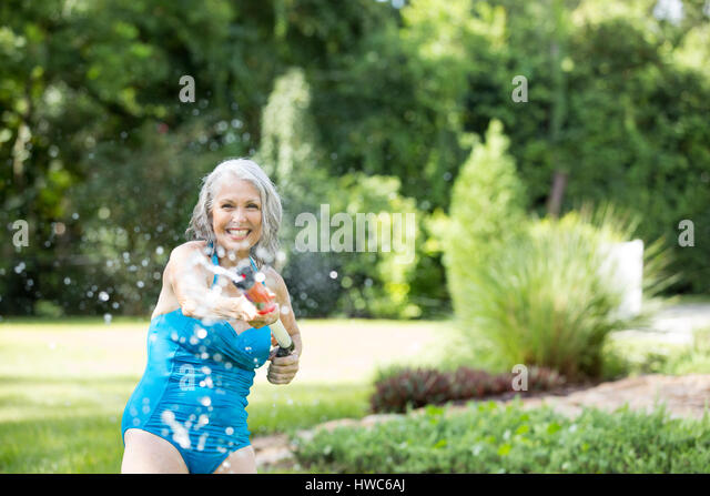 Senior playing with pool toys - Stock Image