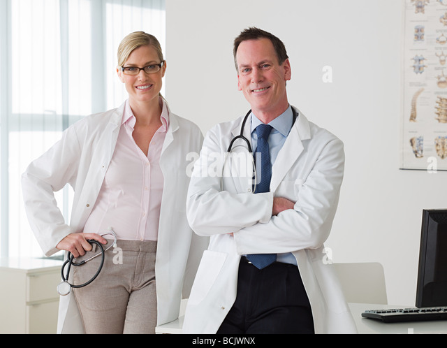 Two doctors in an office - Stock Image