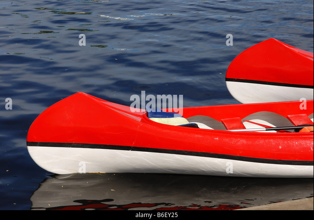 two rowing boats on water, red and white - Stock Image