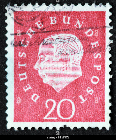 Deutsche Bundespost 20 red stamp - Theodor Heuss 1959 - Stock Image