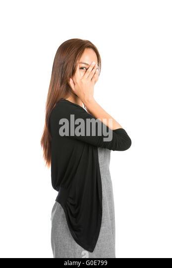 Hand Covering Face Eye Peeking Finger Asian Woman - Stock Image