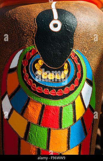 Tribal figure on large garden pot for sale, CBD, Kampala, Uganda - Stock Image