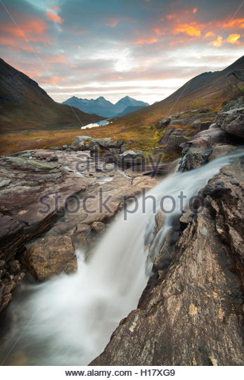 Waterfall at sunrise in Vengedalen, Møre og Romsdal fylke, Norway. - Stock-Bilder