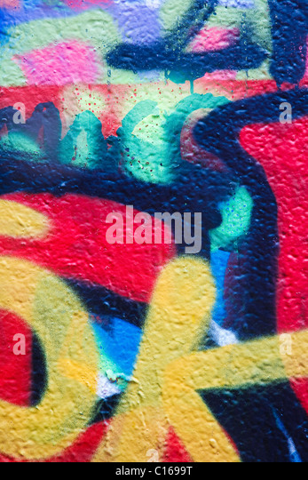 Graffiti on a wall, with detail of many different tags and colors - Stock Image